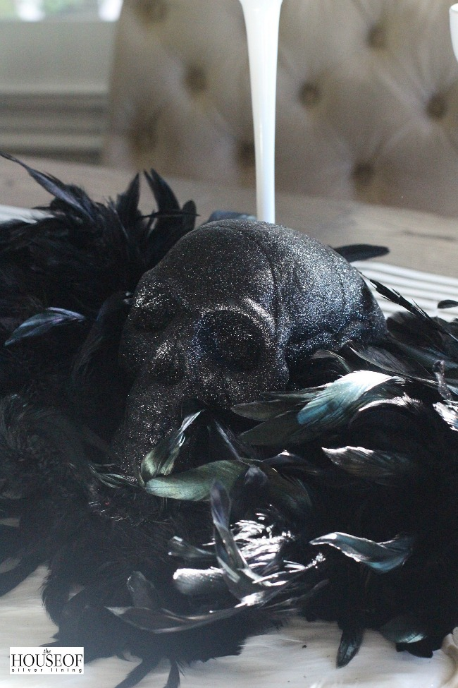 Elegant Halloween tablescape with feathers
