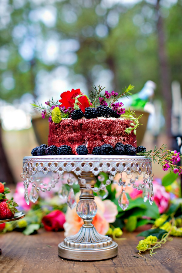 beautiful-cake-with-flowers-berries-in-forest