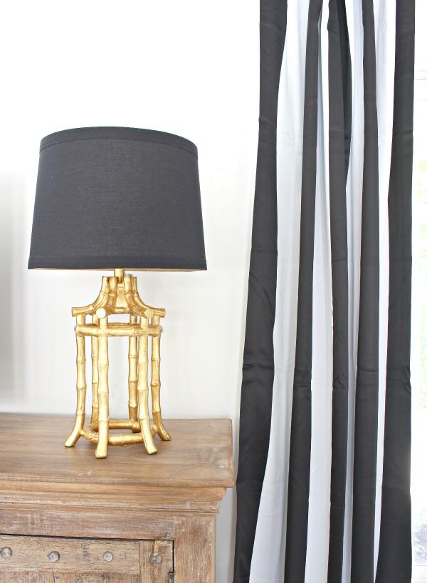 modern-beach-cottage-makeover-family-room-cabana-style-drapes-black-white