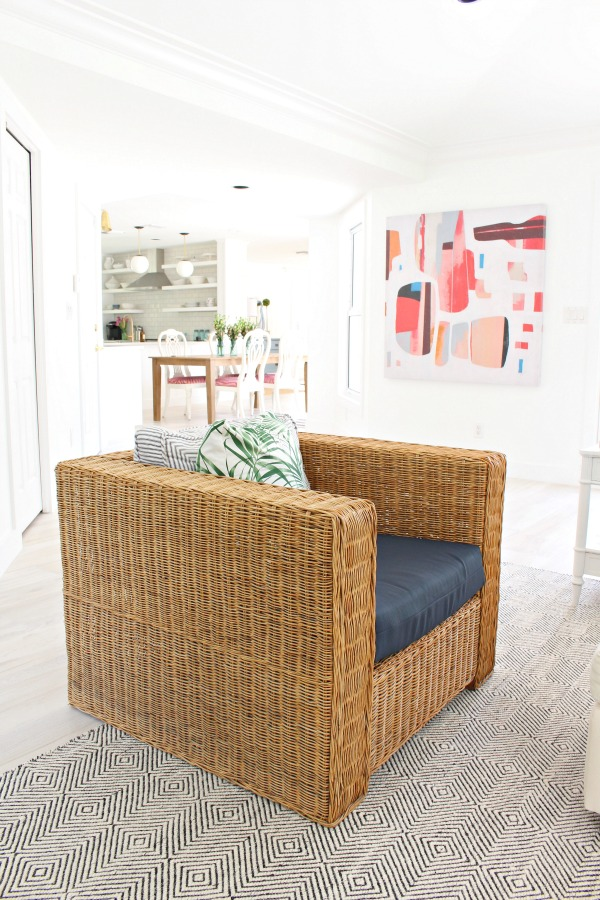 modern-beach-cottage-makeover-family-room-rattan-chair-paddle-rug