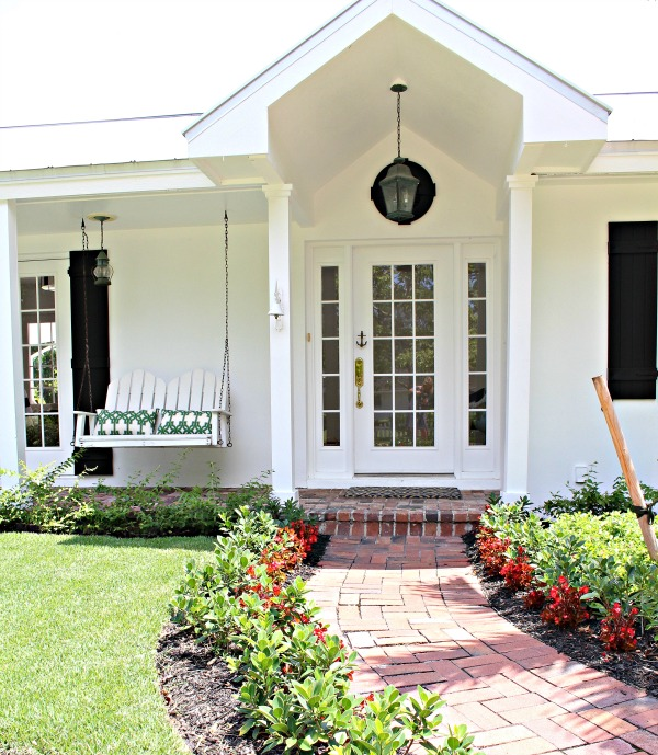 white-house-black-shutter-florida-home-exterior