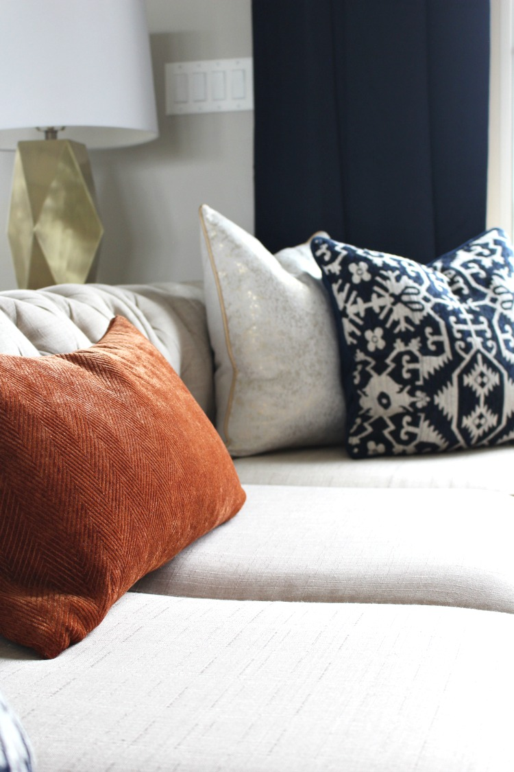 Orange and neutral throw pillows