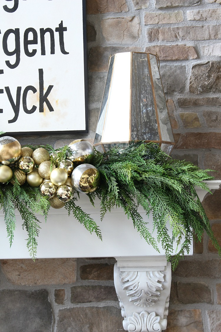 gold-ornament-garland-fireplace-mantel