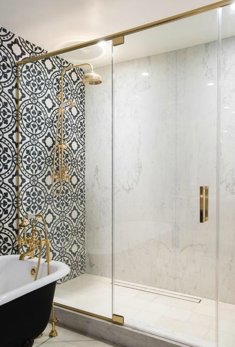 brass-framed-shower-enclosure-marble-slab-surround