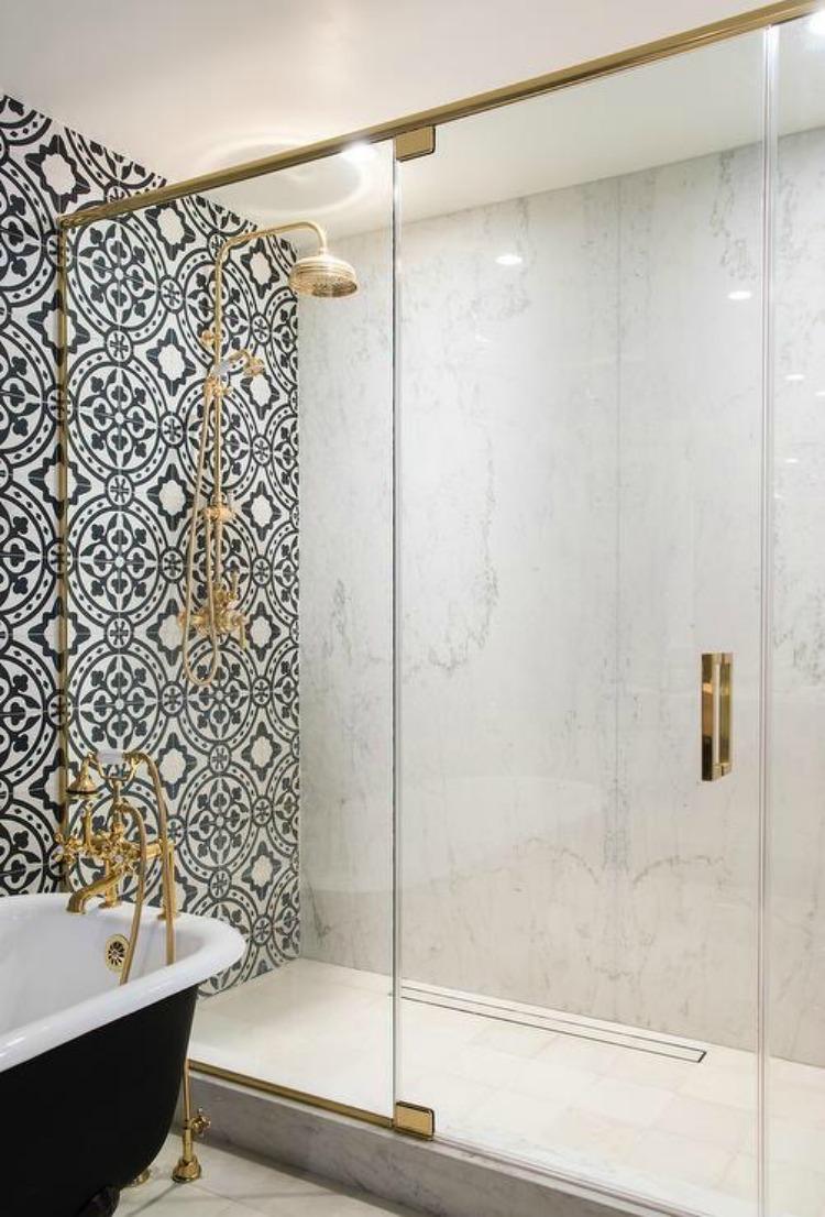 brass-framed-shower-enclosure-marble-slab-surround