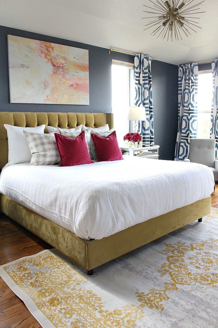 Bold, Beautiful, & Glamorous master bedroom that doesn't shy away from color!