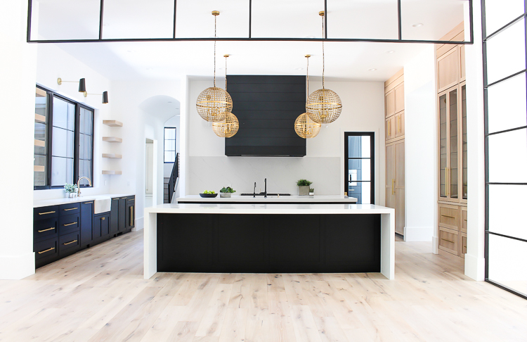 Modern Kitchen with double islands black and rift sawn white oak cabinets open shelves steel transoms