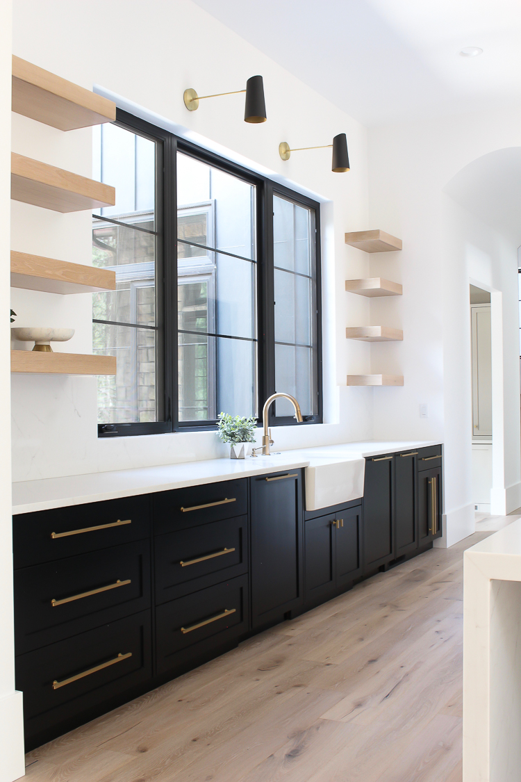 floating white oak kitchen shelves with black lower cabinets