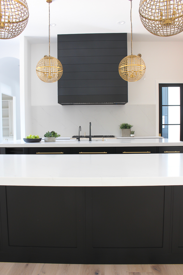 black shiplap hood in modern kitchen