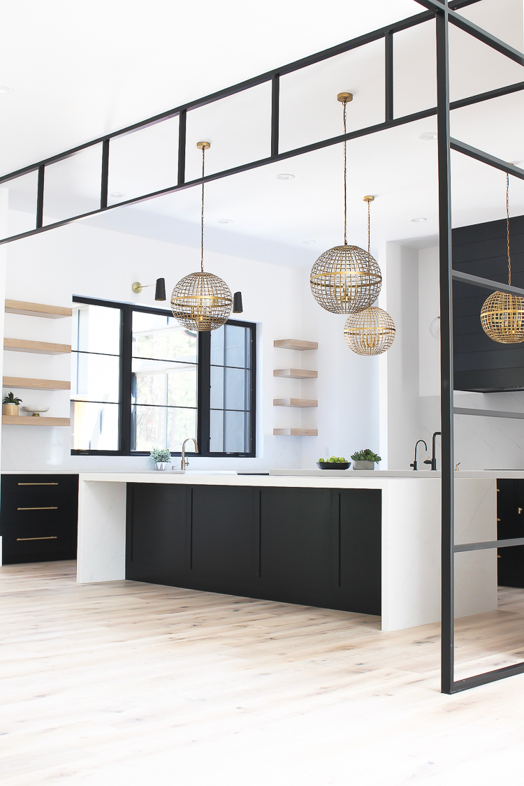 Modern Kitchen with Black and Rift Sawn White Oak cabinets with open shelves and steel transoms