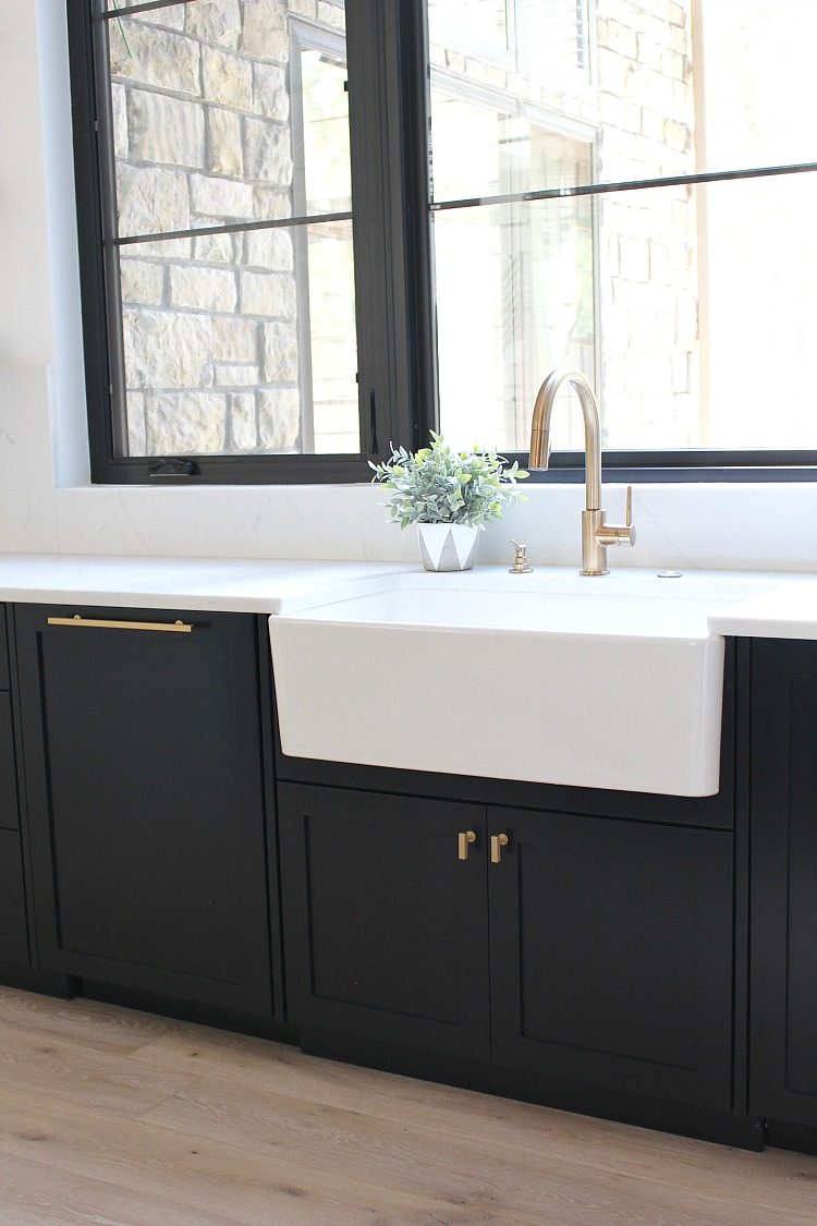 modern kitchen black cabinets open shelves white farm sink