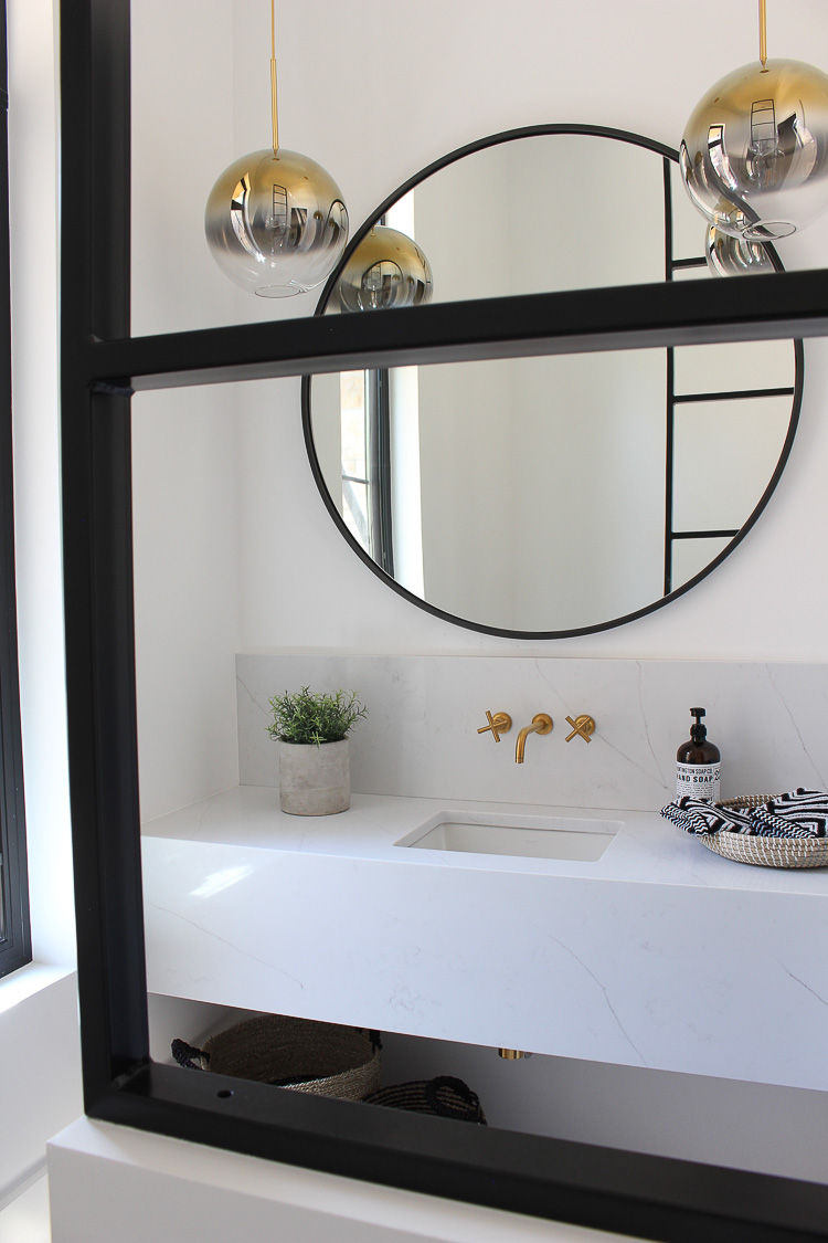 Posh Modern Powder Bathroom with Steel metal room divider