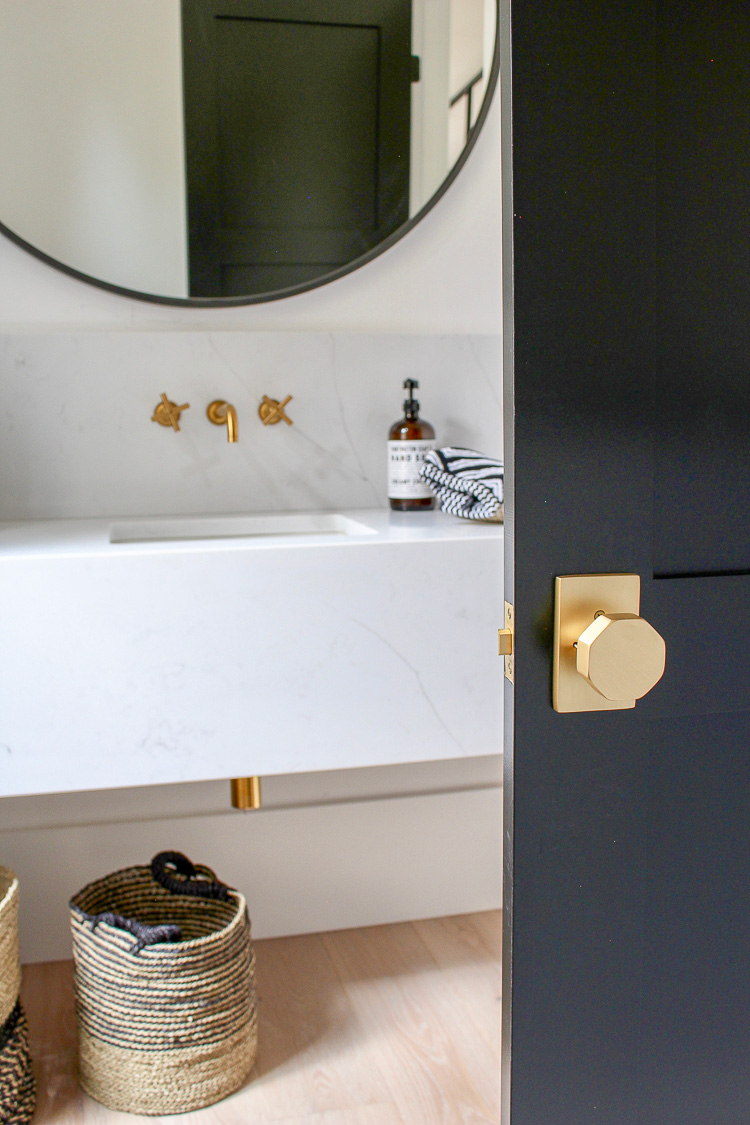 Modern Bathroom with black doors and gold hardware