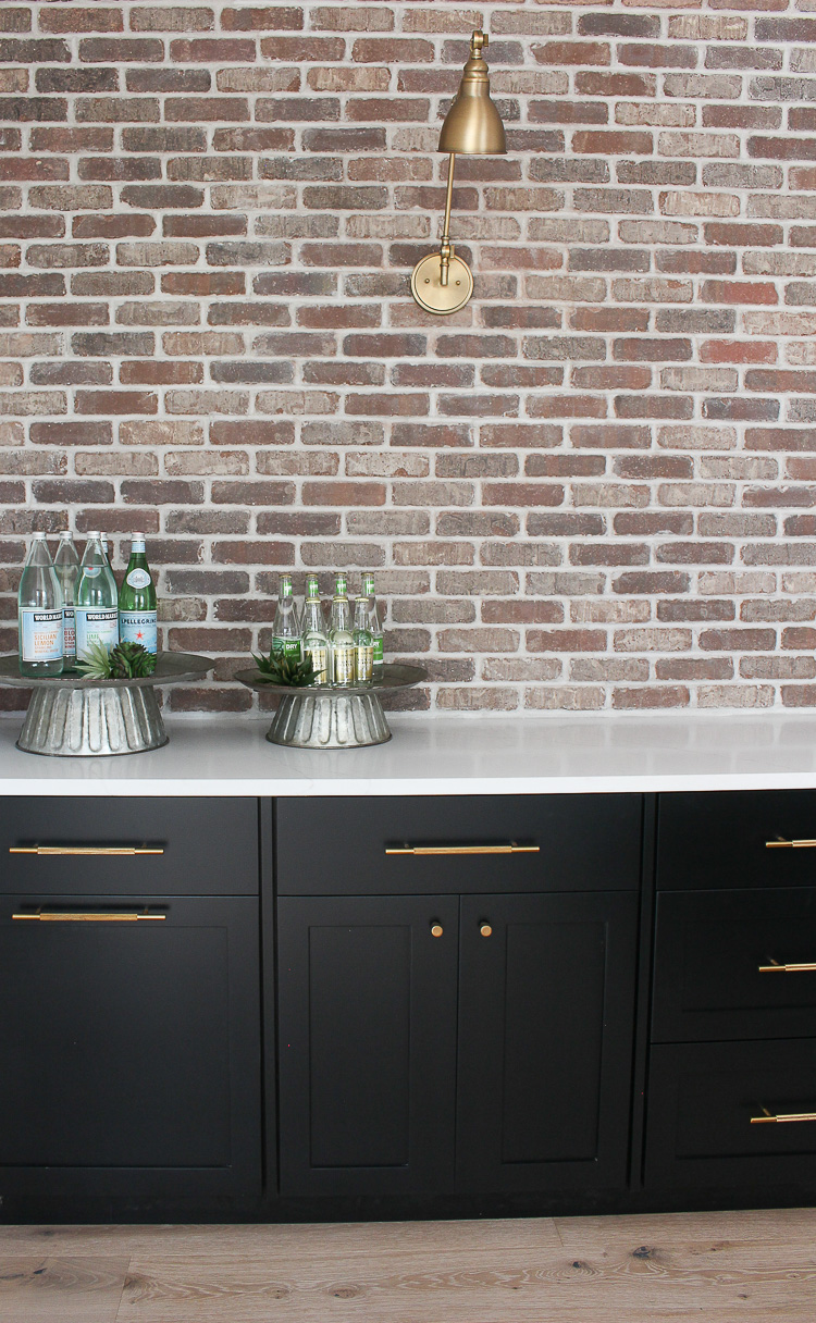 industrial modern bar with brick wall black cabinets