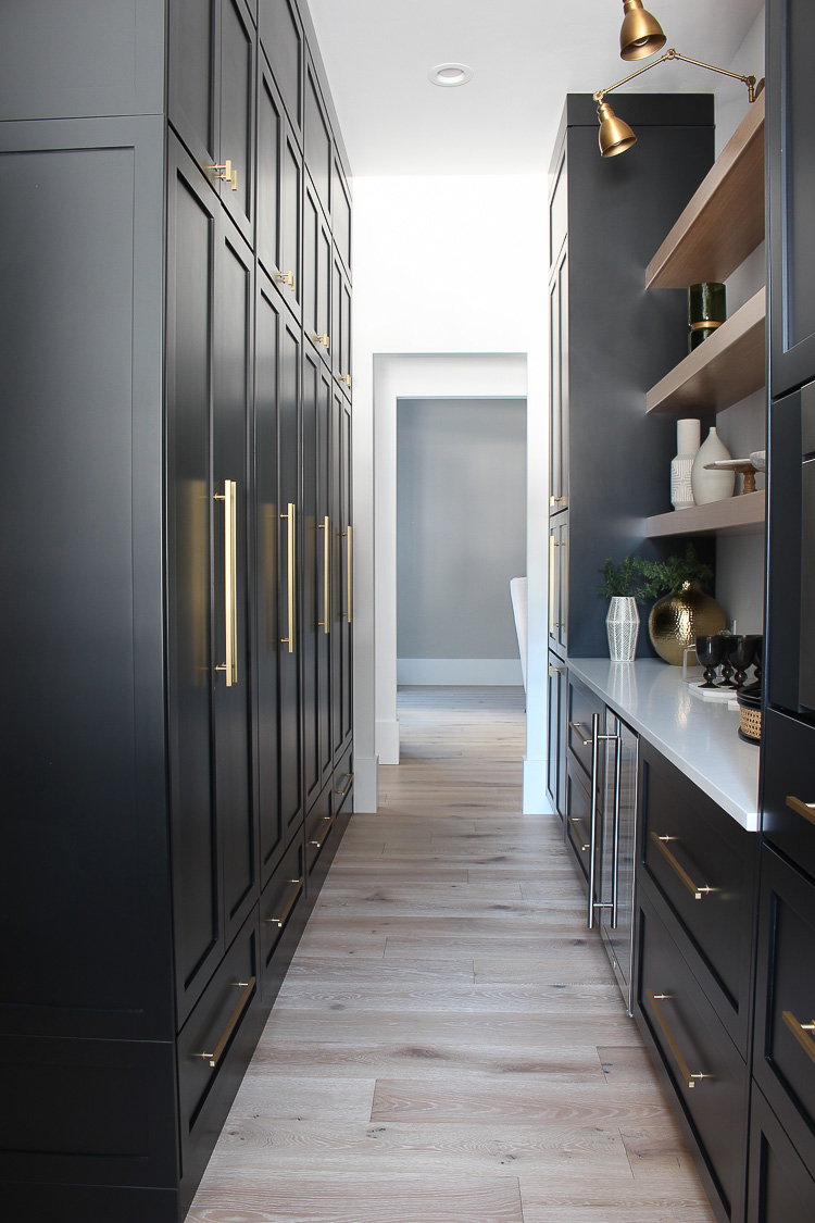 butler's-pantry-black-cabinets-white-oak-floating-shelves-gold-hardware-marble-quartz