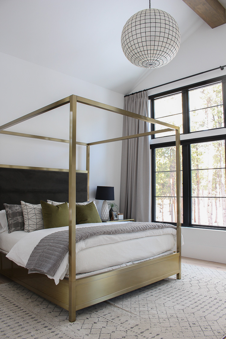 modern-scandinavian-master-bedroom-design-brass-canopy-bed