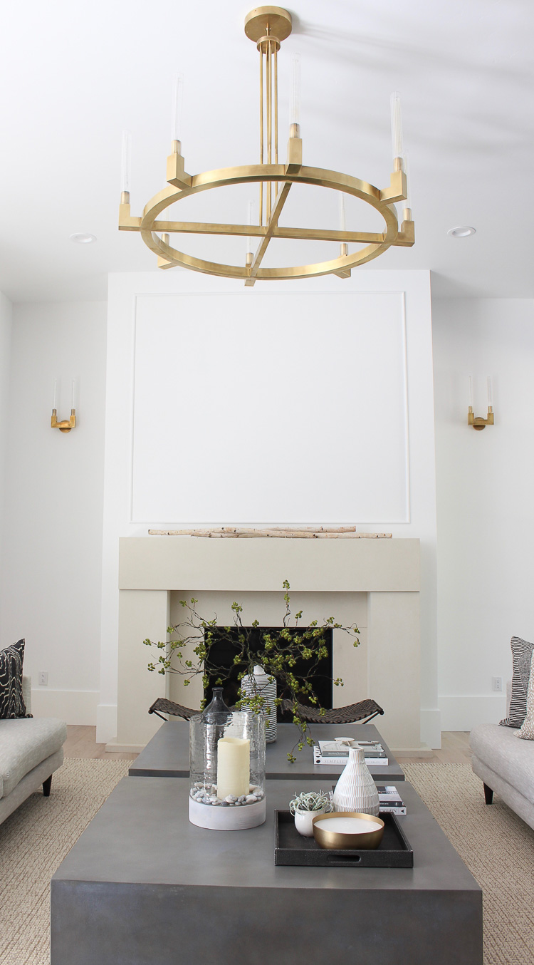 modern limestone fireplace in neutral living room space