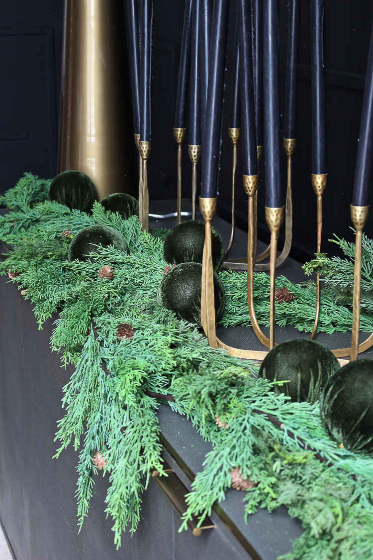 modern elegant christmas decor with garland in black dining room