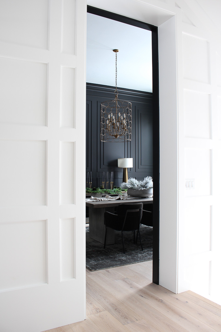moody black dining room with modern crown mouldings christmas style