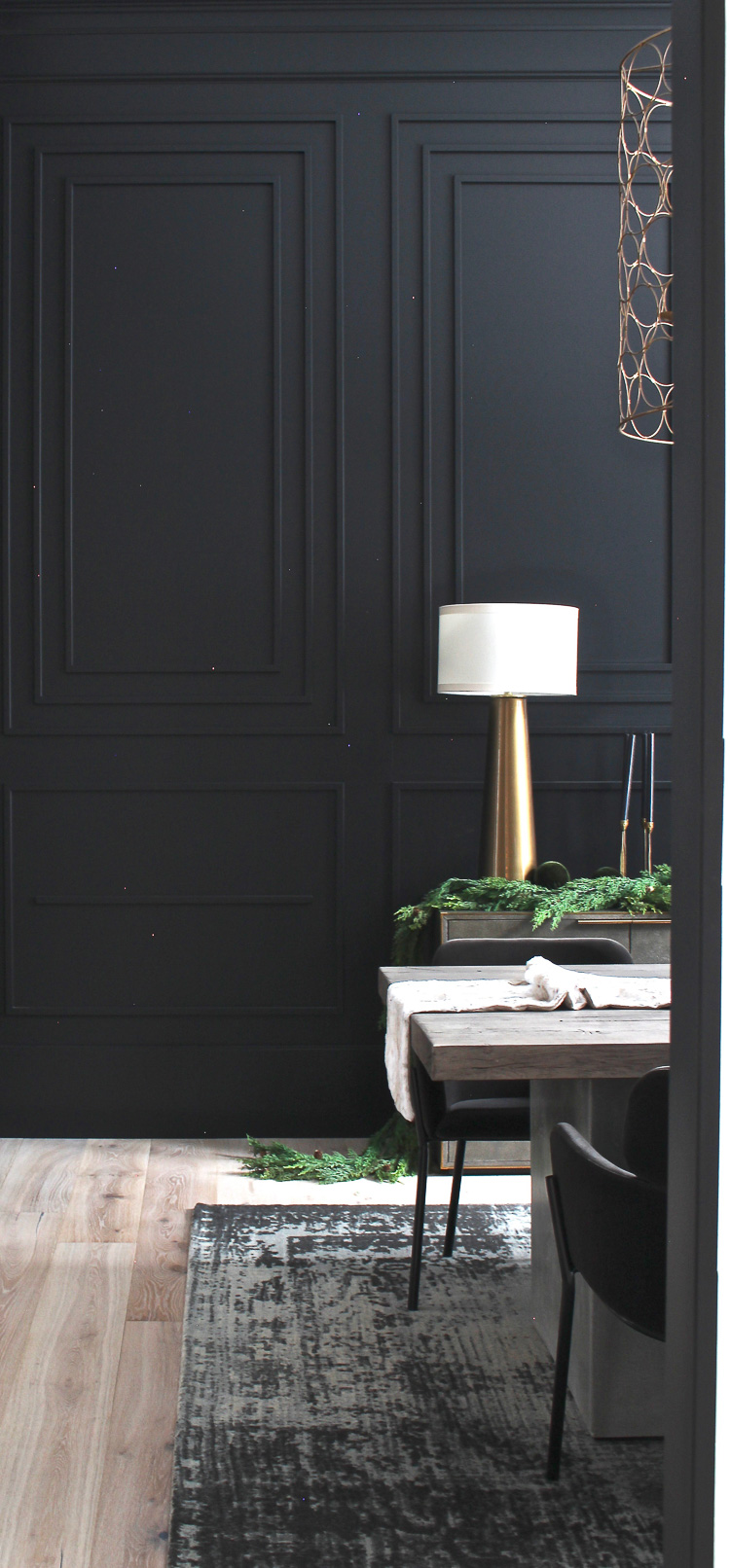 moody dramatic black dining room with modern moulding details