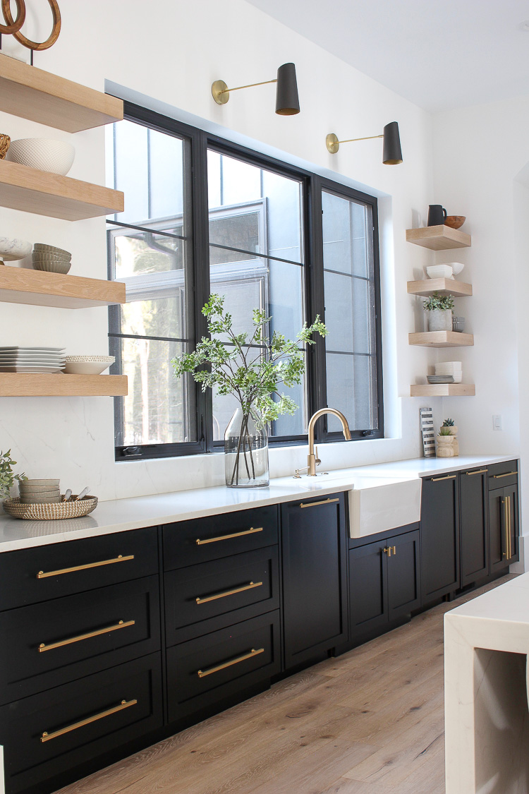 floating white oak shelves with black cabinets kitchen