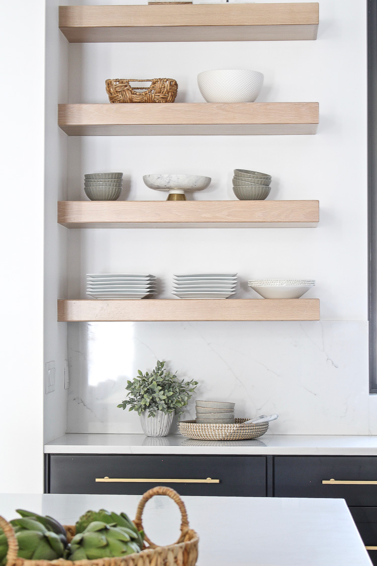 floating white oak shelves in kitchen