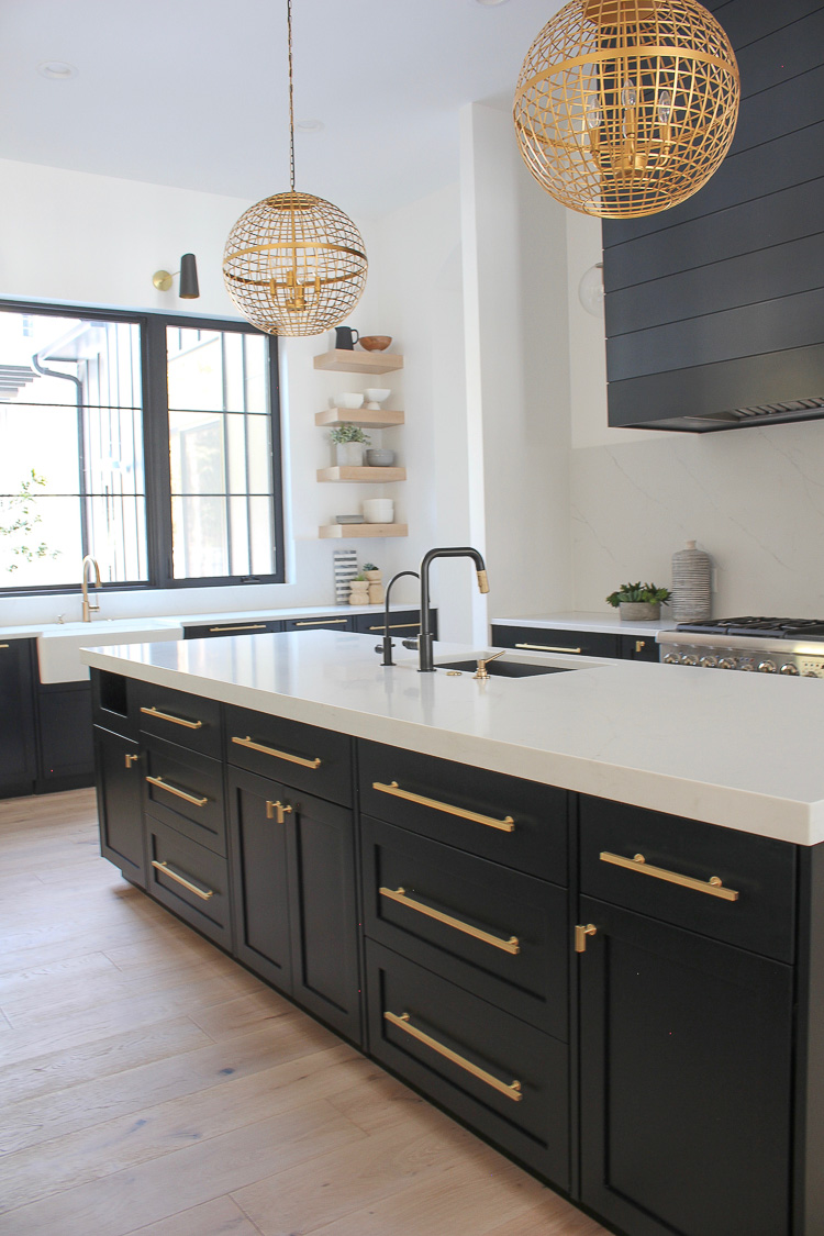 Contemporary kitchen black cabinet islands