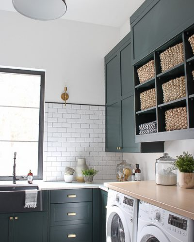The Laundry/Dog Room: Dark Green Cabinets Layered On Classic Black + White Design