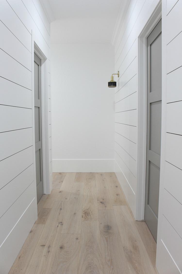white shiplap hallway