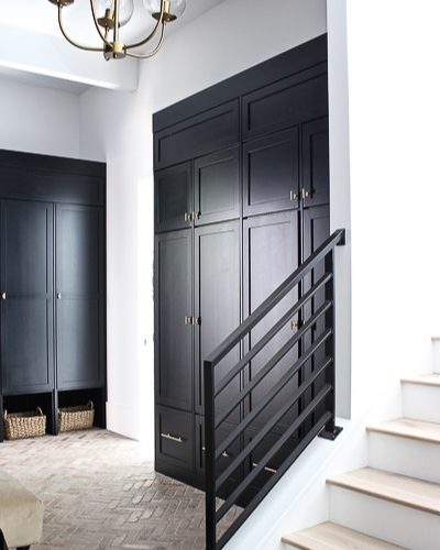 Our Black Mudroom with Brick Herringbone Floors
