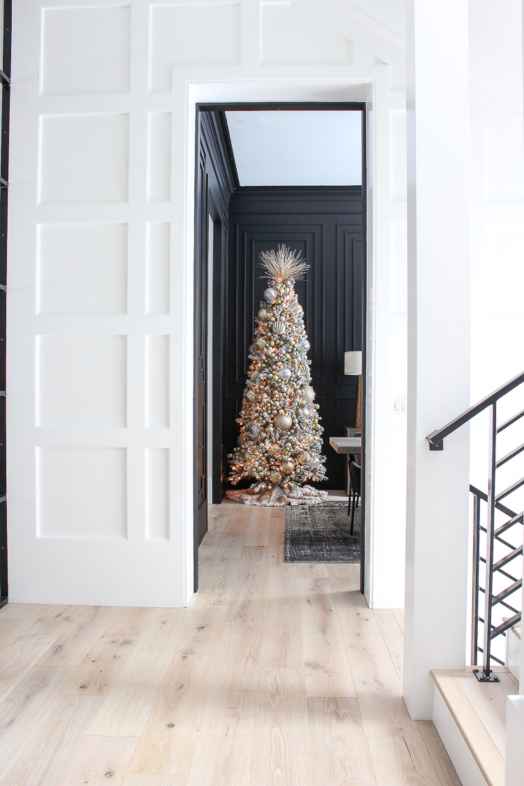 elegant-flocked-christmas-tree-modern-black-dining-room